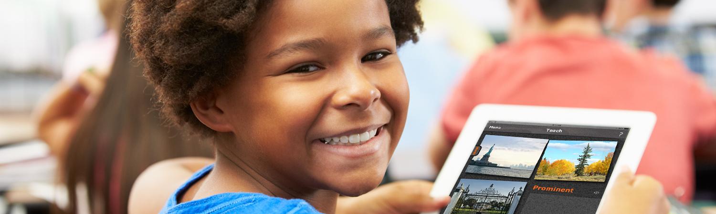 Happy boy using the app