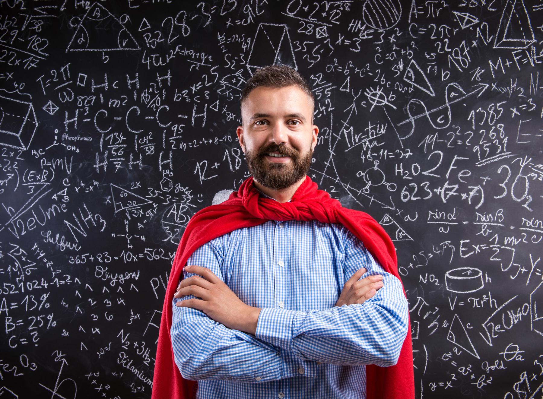 Male teacher wearing superhero cape